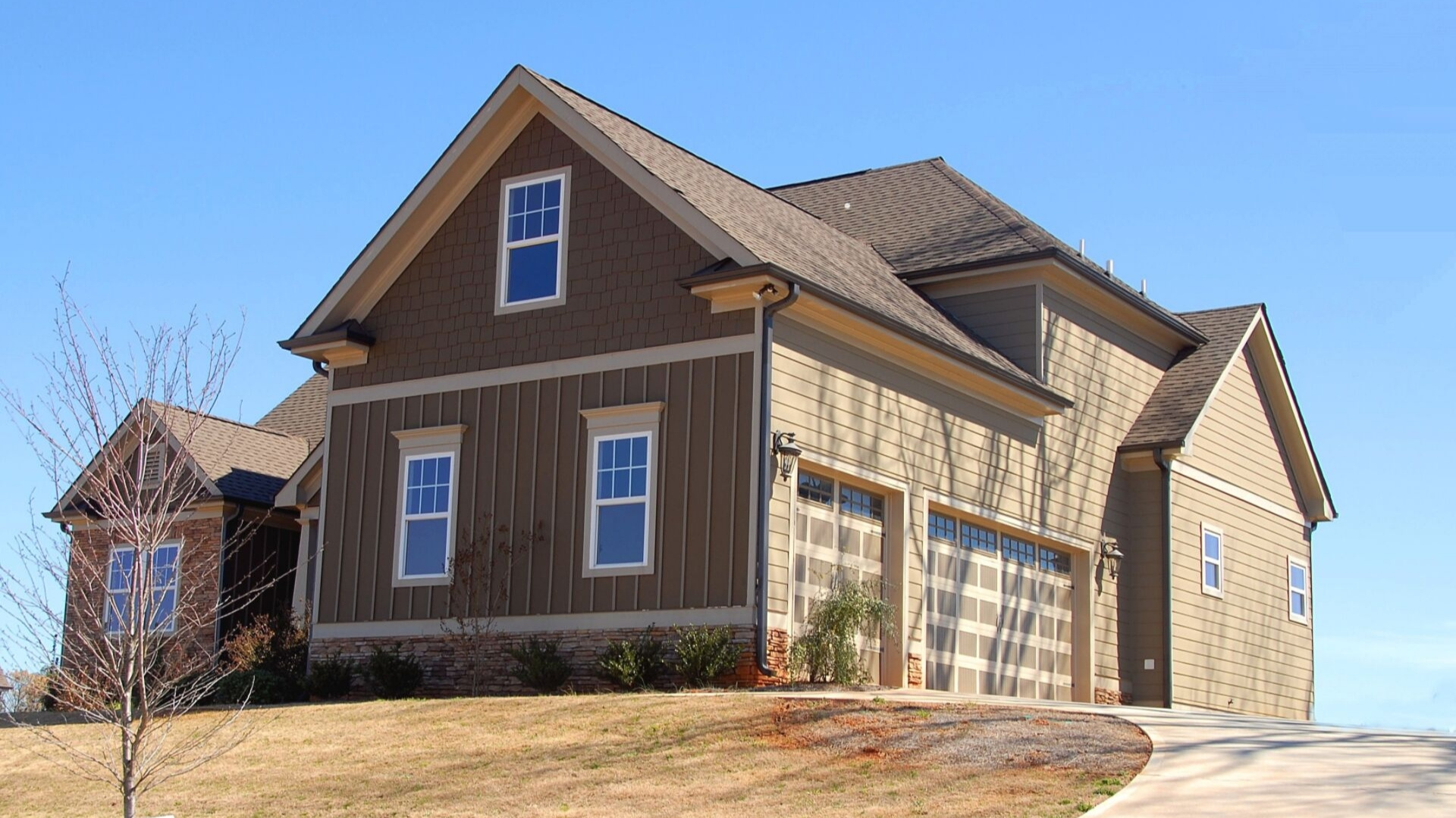 front entrance and garage door renovation improves curb appeal and largest return on investment